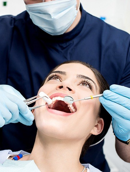 Woman receivin professional teeth cleaning