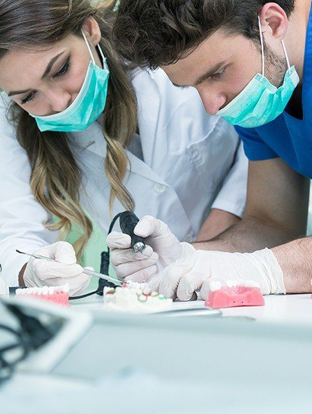Dental team members working with high tech tools