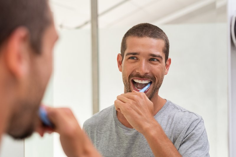 Person with toothbrush